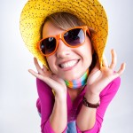 Cute Girl With Funny Hat Smiling In The Studio
